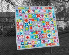 Use 25 fat quarters or your favorite fabric scraps to make this modern medallion quilt featuring patchwork birds and butterflies! The pattern includes full-size template patterns and step-by-step instructions for making an 80