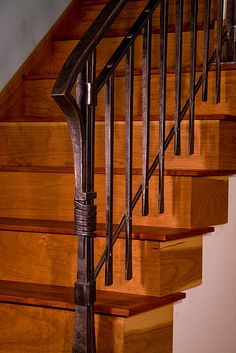 Every component on this handrail was heated, pounded and fitted by www.handforgedworks.com