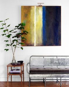 Simple entryway decor with abstract art and vintage bench via @thouswellblog