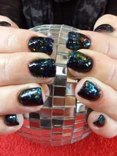 Black gel polish with peacock glitter fade