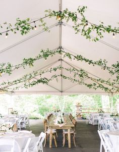 Lovely draped greenery adorning the peaks of a wedding reception tent. Wedding Reception Lighting, Marquee Wedding, Wedding Venues, Wedding Blog, Tent Reception, Event Lighting, Wedding Ideas, Wedding Music, Reception Ideas