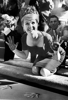 Fun photo of Debbie Reynolds placing her handprints in the wet cement at Grauman's Chinese Theatre in Hollywood on Jan. 14, 1965. (Los Angeles Times)
