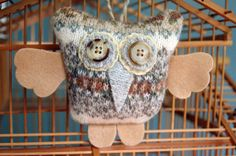 Handmade with love, using repurposed wool sweaters, recycled wool felt and vintage buttons. One of a kind.    The eyes and nose are made from grey and