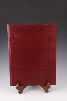 This red, cracked leather travel book features photos of our nations capitol. Images from DC are interspersed with pages for your writings and
