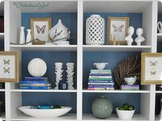 blue at the back of the shelfs AND glass spray painted goodwill items for decor