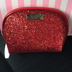 NWTVS Red Glitter Handbag/MakeUp Bag NWT. VS Stunning red glitter (textured feel) handbag/ makeup bag. Black liner. Zipper closure. Get it before it is gone. Perfect for Valentines Day/ Date Night or Prom.❤️ (2) Available ❌ listing is for only 1 item. Victoria's Secret Bags Cosmetic Bags & Cases
