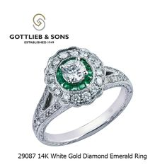 This elegant vintage inspired 14K White Gold Diamond Emerald ring is perfect for any occasion.  This #emerald and diamond ring features a round center diamond enclosed by a halo of emeralds surrounded by a scalloped #diamond halo and hand engraving on the band. Visit your local #GottliebandSons retailer and ask for style number 29087. http://www.gottlieb-sons.com/product/detail/29087