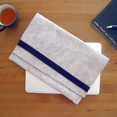 Sew a simple laptop sleeve made out of wool felt and soft fleece, complete with an inner pocket for storing small accessories.
