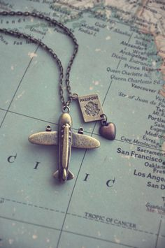 This is one of my favorite necklaces, because, well, I absolutely love to travel! An antiqued brass airplane, a little passport and a copper heart