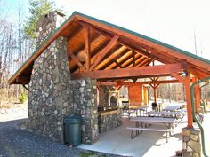 Outdoor heavy timber pavillion with full kitchen and fireplace.