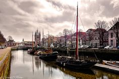 https://flic.kr/p/sQpuBP | Zierikzee Zuidhavenpoort | This image shows the Zuidhavenpoort of Zierikzee, a small village in Zeeland. Zeeland consists of a group of islands of the Netherlands, Europe. You can see some old ships floating in the foreground and the famous harbor gate in the background. In the village you can find the old maritime architecture which is characterisic for this area of the Netherlands.