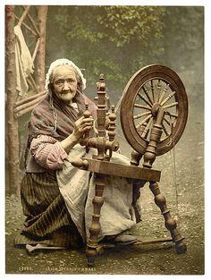 elderly Scottish woman at a spinning wheel