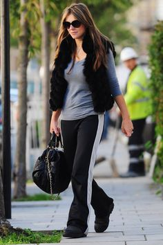 10. Elizabeth Hurley looks all over the place in her track pants and fur vest. Is she going for a glam sports look, because it's not working!