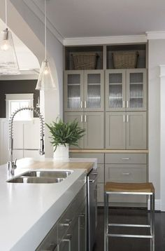 TerraCotta Properties - Contemporary kitchen with tapered glass pendants, taupe gray ...