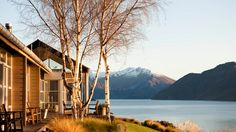 Whare Kea: a gorgeous six room lodge set on the shores of Lake Wanaka. You'll wake up surrounded by nothing but mountain peaks and sunshine, and have a day of as much relaxation or adventure as you want.