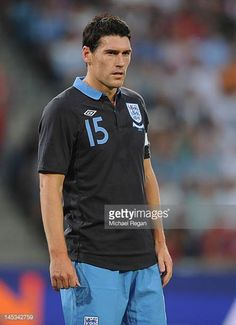 Gareth Barry Photos - Gareth Barry of England looks on during the international friendly match between Norway and England at the Ullevaal Stadion on May 2012 in Oslo, Norway. - Norway v England - International Friendly West Bromwich, Norway, That Look, Polo Shirt, England, Sporty, Oslo, Mens Tops, Image