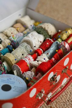 Ribbons in lunch box or an old suitcase.  This is a real helpful way to keep ribbons organized and from getting dusty.