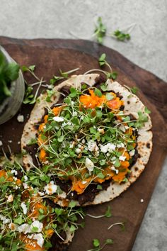 Healthy vegetarian sweet potato tostadas made with cilantro-lime mashed sweet potatoes and spiced black beans, served on crisp tortillas.