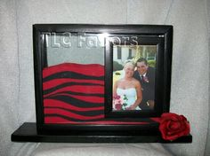Sand ceremony with red, black and white sand..pic of  us& our children inside frame idea...