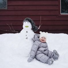 Happy snowbaby and his snowman.