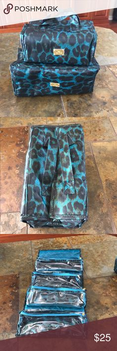 "JM NEW YORK BEAUTY CASE SET NWOT! ""JM NEW YORK "" roll up travel beauty case set. Fun leopard print. Larger case has 2 removable velcro compartments and smaller bag all 4 are removable. Still have protective plastic on gold hardware. Great bag! Keeps things organized and easy to see.  Lg bag W 11"" L 5"" D 5.5"" SM bag  W 8"" L 4"" D 5"" measurements taken when bag folded.  Nonsmoking *** JM New York Bags Cosmetic Bags & Cases"