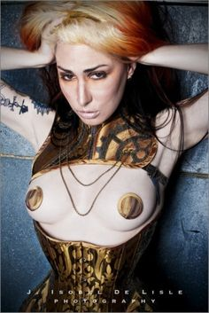Always finding photos of me that people repost online...      Photo:  J. Isobel De Lisle  Make-Up:  Anna DeMeo  Posture Collar/Pasties/Corset:  Elektra Designs