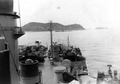 NH 103338. USS Sausalito (PF-4). View looking aft from the ship's port bridge wing, circa 1952. Probably taken at Yokosuka, Japan Photographed by James Edward Taylor, who was then a member of Sausalito's crew. A U.S. Navy submarine is visible in the middle distance. Collection of James Edward Taylor. Courtesy of his wife, Mary A. Taylor, 2005. U.S. Naval History and Heritage Command Photograph.