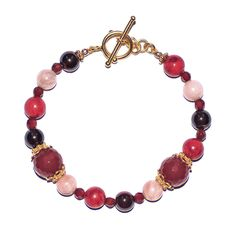 This Coral, Moonstone, Garnet, and Carnelian toggle bracelet is inspired by Isthar, the Babylonian goddess of fertility, love, war, and sex.