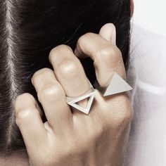 Versatile matte finish Sterling Silver reversible ring that is designed to be worn multiple ways. One side of the ring is an open triangle, the other is solid.