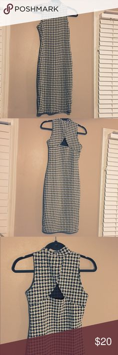 Rebel Sugar Knit Dress LIKE NEW Rebel Sugar Black & White Knit Patterned Dress. Perfect Condition w/no signs of wear.  Very Figure Flattering. Comes from smoke free and pet free home. All of my items are shipped fresh and clean. BUNDLE AND SAVE. 30% OFF BUNDLES OF 3 OR MORE! Rebel Sugar Dresses Midi