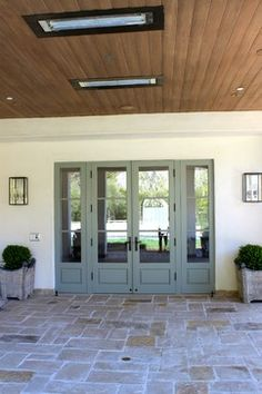 French doors from dining room to out door room