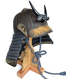 Japanese Samurai War Helmet Kabuto in Suji Bachi style (multy-plated) with 32 ribs and with wooden Shikami head maetate.  Mid Edo period
