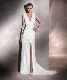 Antara - Vestido de novia en tul, manga larga, pedrería y escote pico
