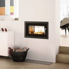 Rais 2:1 : A double sided fire with an exceptionally beautiful widescreen design and clean lines that give exceptional views from both sides. #kernowfires #wadebridge #redruth #cornwall #rais #fire #stove #wood #burner #double #sided #modern #contemporary #design #life #style #flames #view #house #home