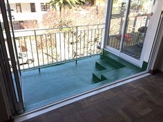 """Cemflex waterproofing to an apartment balcony in Cape Town, finished with green """"stoep"""" paint."""