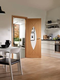 The Pesaro Internal Oak Door is a uniquely curved unfinished oak door with clear glass.