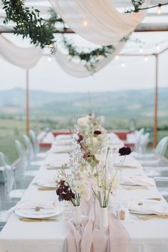 La Tavola Fine Linen Rental: Tuscany White with Aurora Mauve Table Runner and Hemstitched White Napkins | Photography: Tatyana Chaiko, Planning: Nomad Republic, Florals: Puscina Flowers, Venue: La Bandita Countryhouse in Pienza, Toscana, Rentals: Creations Ceramique, Preludio Noleggio and Simple Things Ceramics, Lighting: Wedding Music and Lights