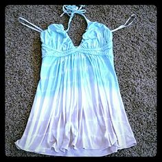 New sky top Beautiful flowy sky top with an ombre beach look. This has never been worn but tag was removed. I paid $112 for this top on vaca last year and I just never wore it. Sky Tops Tank Tops