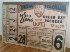 Detroit Lions game ticket recreated using multiple layers of both cut and raised wood pieces and laser engraving | 3'x4′