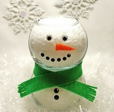 Cute  mini fish bowls, some felt, googley eyes and adhesive gems to create this adorable little snowman centerpiece.