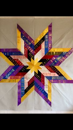 Quilted star created from dog show ribbons.   Follow Lucky Fox Ribbons foote great ideas!