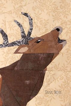 Roaring Deer Quilt Block - Add a touch of the wild woods to your home or quilt patterns when you download this free paper piecing block pattern. The Roaring Deer Quilt Block features a majestic deer and comes with a downloadable template. Not for quilters who are brand new to paper piecing, this free pattern is a true work of art and is completely stunning on its own. You can easily add this block to a nature quilt or size up the block pattern to make a wallhanging.