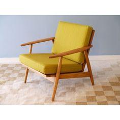 2a3bcf83f71ec2 Fauteuil vintage design scandinave en hêtre, coussins jaune moutarde,  design danois confort et look retro pour ce modèle très tendance,  disponible chez la ...