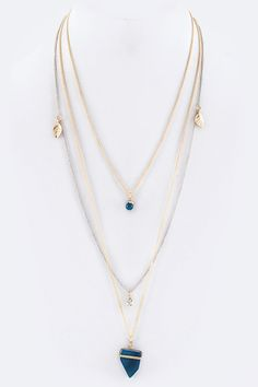 """Two-tone delicate chain necklace with navy stone pendant. Gold and silver - Get it at www.firstandchic.com - """"Be Soft & Powerful."""""""