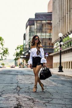4536b9756b9d fashion blogger mia mia mine wearing a white off-the-shoulder top with black