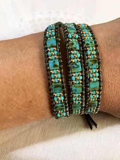 Pretty 5mm Blue Turquoise Picasso tila beads wrap bracelet, turquoise and 24KT Gold Plated Miyuki. Made with brown leather wire 1.5 mm and silver button. Possibility of larger size to order.