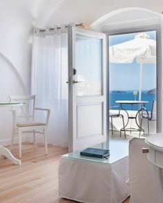 Katikies Hotel  ( Santorini, Greece )  Rooms, like this Superior Suite, have parquet floors, white furnishings, and private terraces. #Jetsetter #JSVolcano