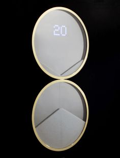 DUNE CLOCK, (2015) A semi-digital hour glass using 3 million precision cut crystals.  The double circular form references orbiting planetary bodies, the crystal's faceted structure lock together creating geometric shapes in the clock as they fall.