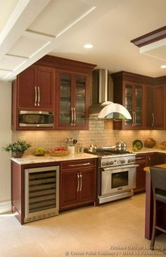 Kitchen Of The Day This Small Kitchen Features Traditional Rich - Kitchen ideas with cherry wood cabinets