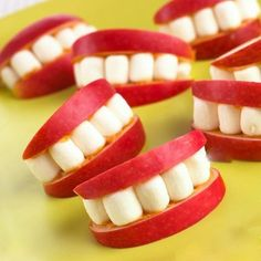 Guess what is made of these funny teeth which is suitable for Holloween Day?   Apple and cotton candy :>